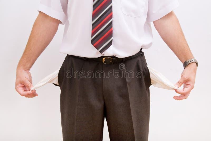 Homem de negócio com bolsos vazios foto de stock royalty free