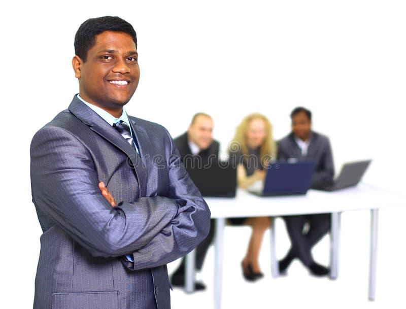 Homem de negócio com colegas de trabalho foto de stock royalty free