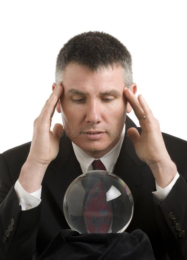 Homem de negócio com esfera de cristal imagem de stock