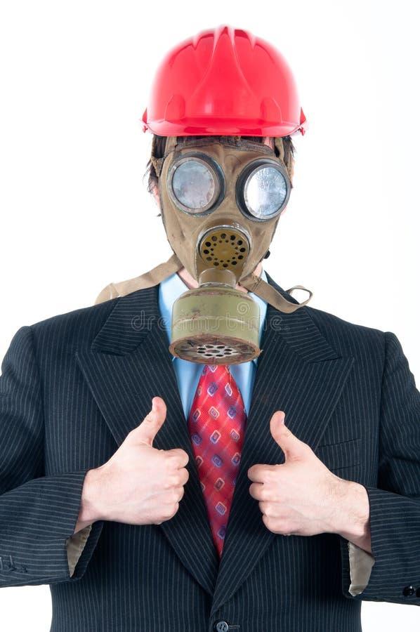 Homem de negócio com máscara e capacete de gás imagens de stock royalty free