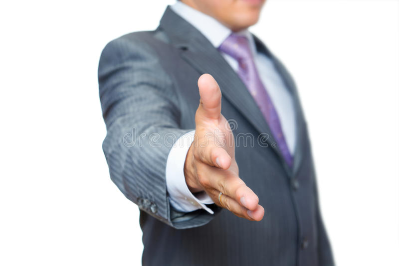 Homem de negócio com a mão estendida ao aperto de mão imagens de stock