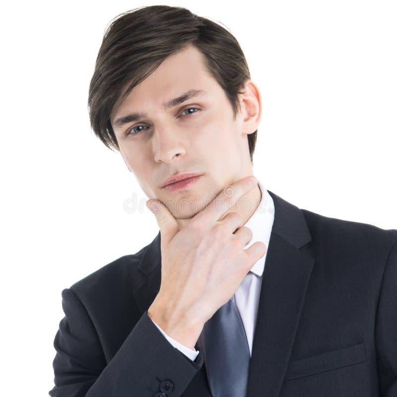 Homem de negócio com mão no queixo imagem de stock royalty free