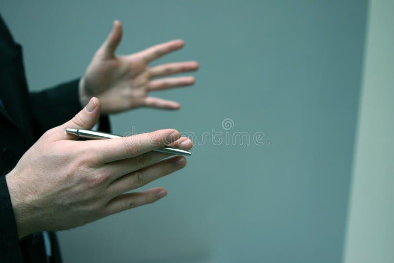 Homem de negócio com mãos imagens de stock