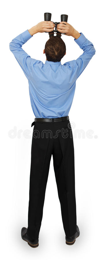 Homem de negócio com o laço azul com os binóculos que olham acima imagens de stock
