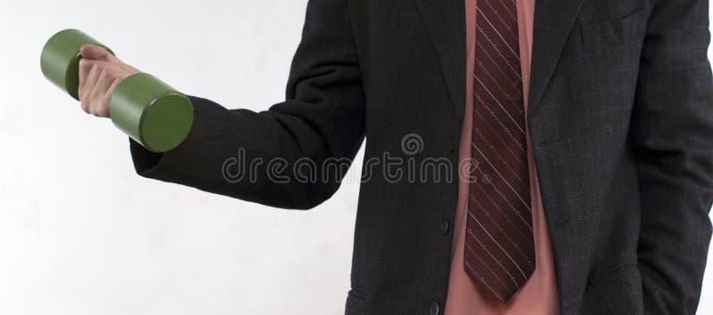 Homem de negócio com peso foto de stock royalty free