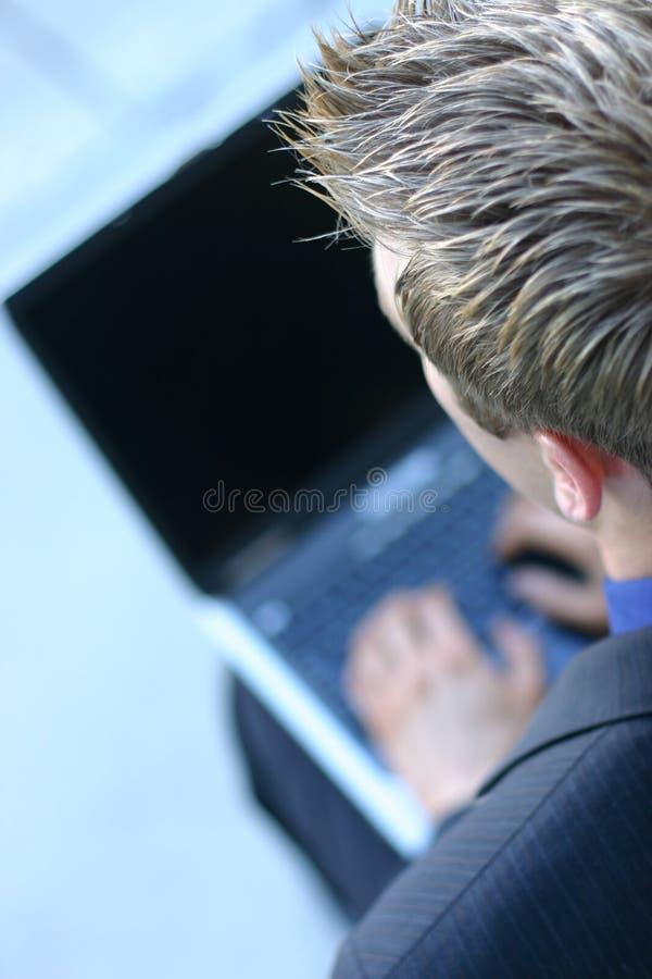 Homem de negócio com portátil fotos de stock