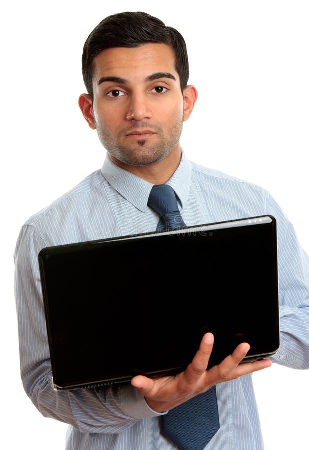Homem de negócio com portátil aberto foto de stock royalty free