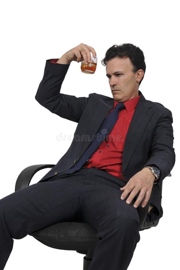 Homem de negócio com um cocktail imagem de stock