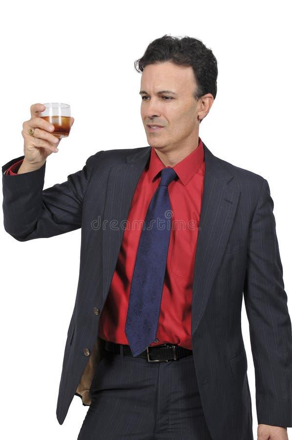 Homem de negócio com um cocktail fotos de stock royalty free