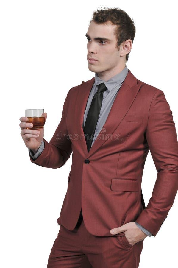 Homem de negócio com um cocktail fotografia de stock