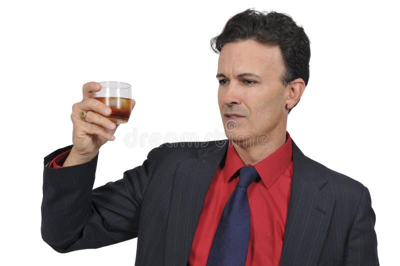 Homem de negócio com um cocktail imagem de stock royalty free