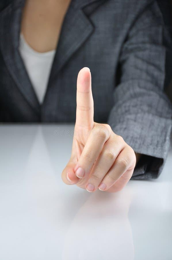 Homem de negócio com um dedo direto fotografia de stock royalty free