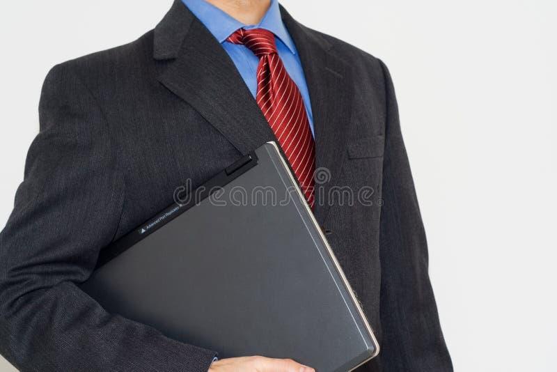 Homem de negócio com um portátil fotografia de stock royalty free