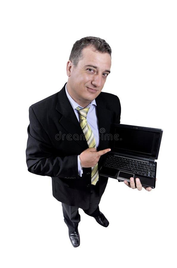Homem de negócio com um portátil foto de stock