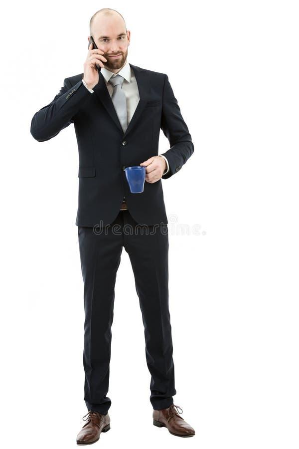 Homem de negócio completo do comprimento que fala no telefone imagens de stock royalty free