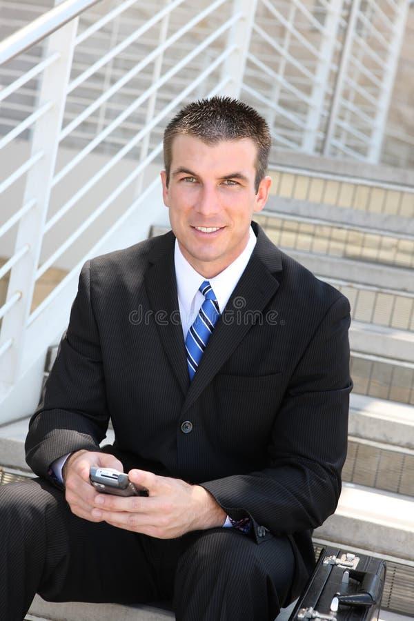 Homem de negócio considerável no escritório foto de stock