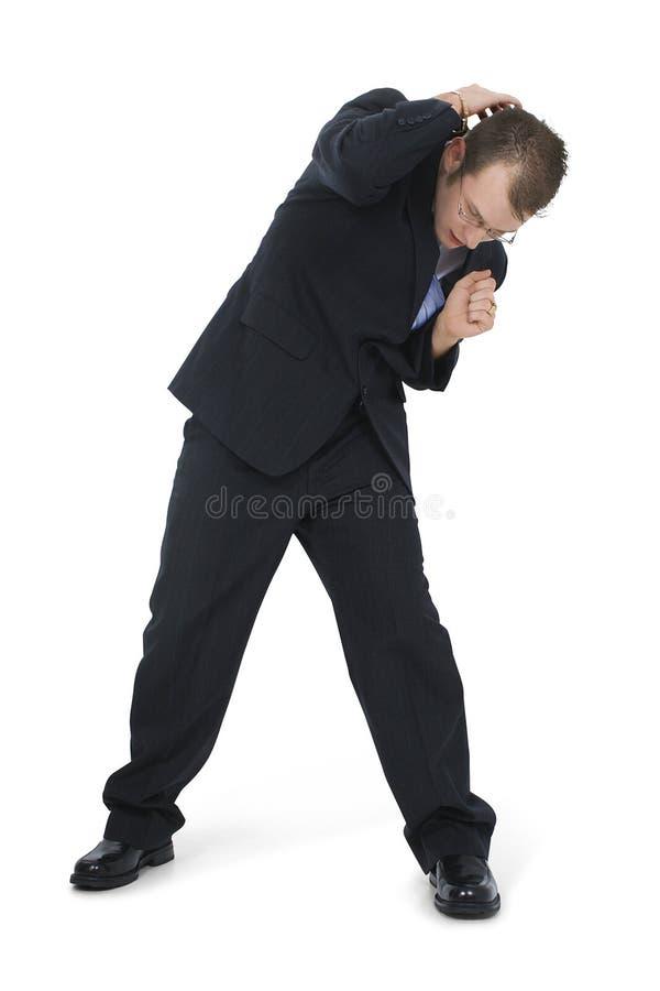 Homem de negócio Cowering no terno fotos de stock royalty free