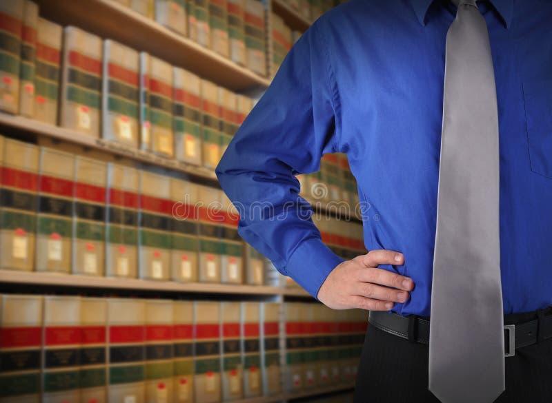 Homem de negócio da lei de Libray com laço fotos de stock royalty free