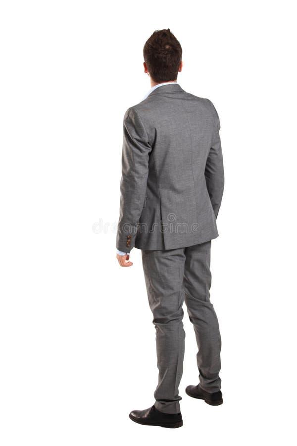 Homem de negócio da parte traseira - olhando algo fotos de stock