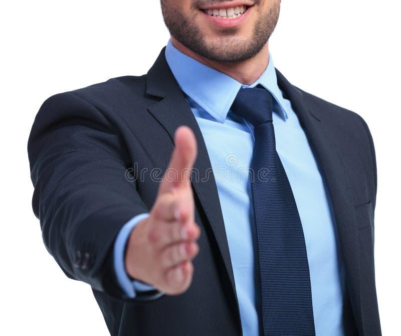Homem de negócio de sorriso pronto para selar o negócio imagem de stock