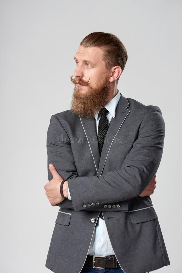 Homem de negócio do moderno que olha ao lado imagens de stock