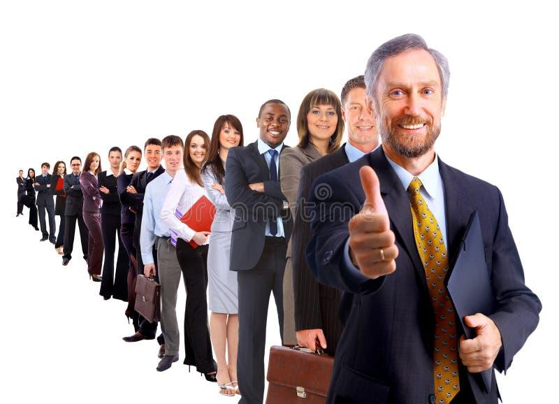 Homem de negócio e sua equipe mim foto de stock