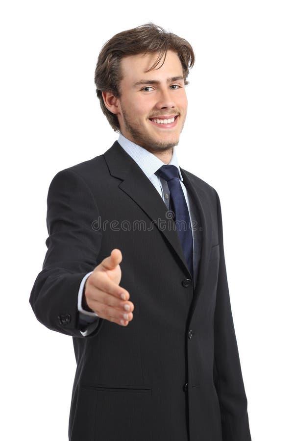 Homem de negócio feliz novo pronto ao aperto de mão foto de stock royalty free