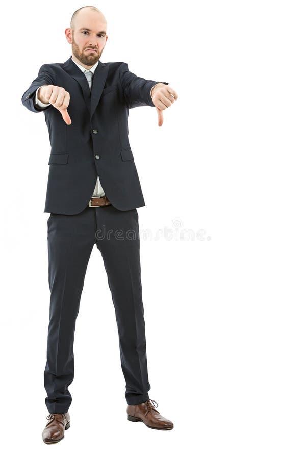 Homem de negócio frustrante que mostra os polegares para baixo imagem de stock