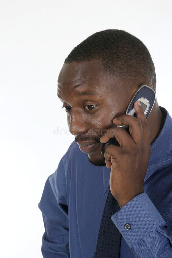Homem de negócio interessado no telemóvel 2 fotos de stock