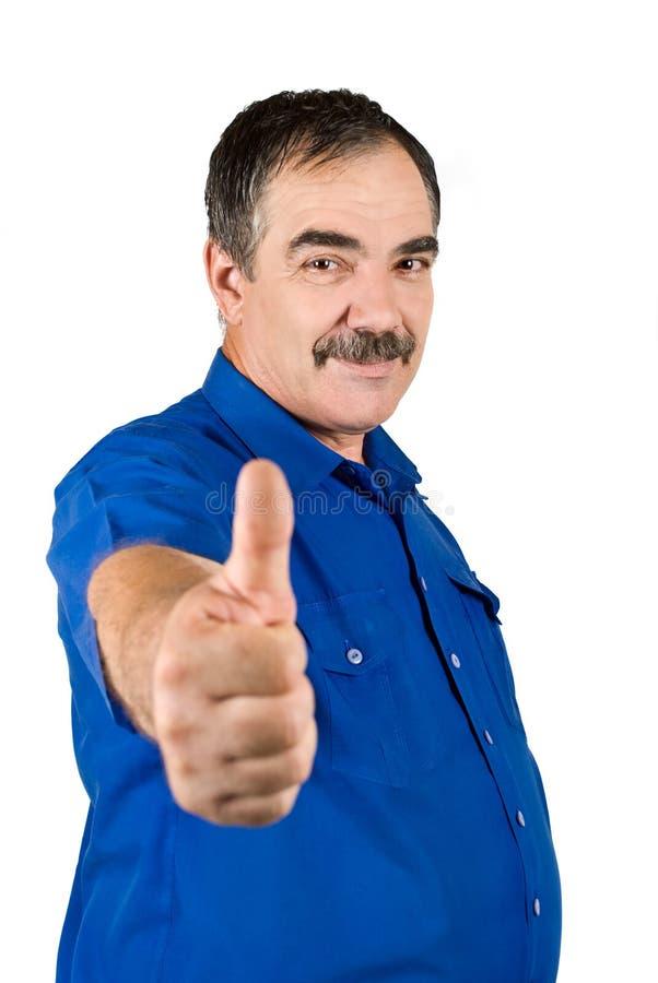 Homem de negócio maduro que dá os polegares acima foto de stock