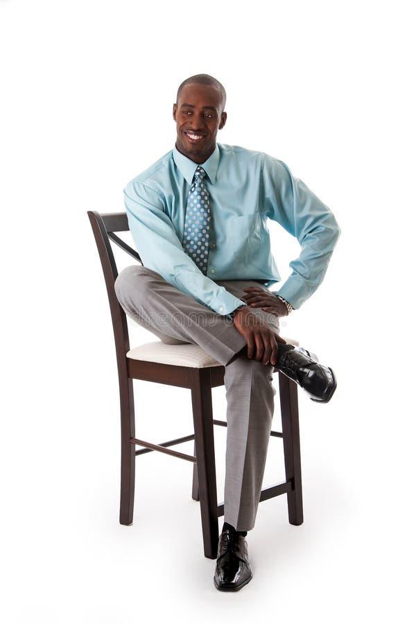 Homem de negócio na cadeira fotos de stock royalty free