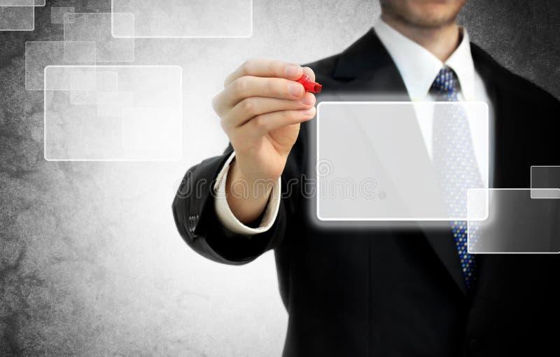 Homem de negócio na frente da tela de toque fotografia de stock royalty free