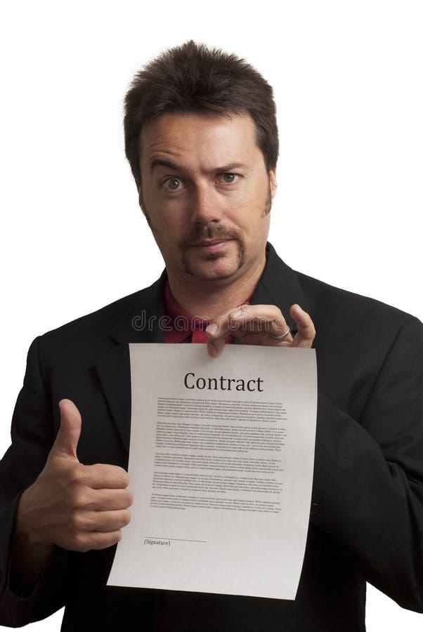 Homem de negócio Nerdy, com um contrato falsificado fotografia de stock
