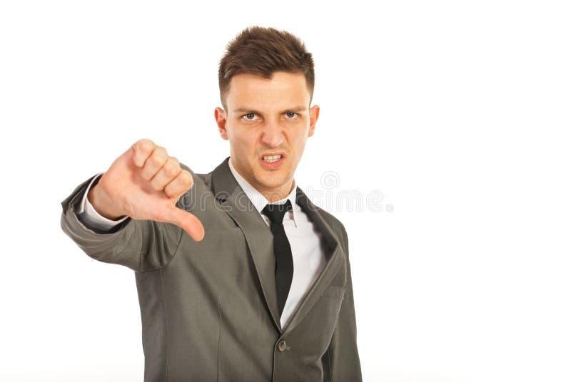 Homem de negócio nervoso com polegar para baixo foto de stock royalty free