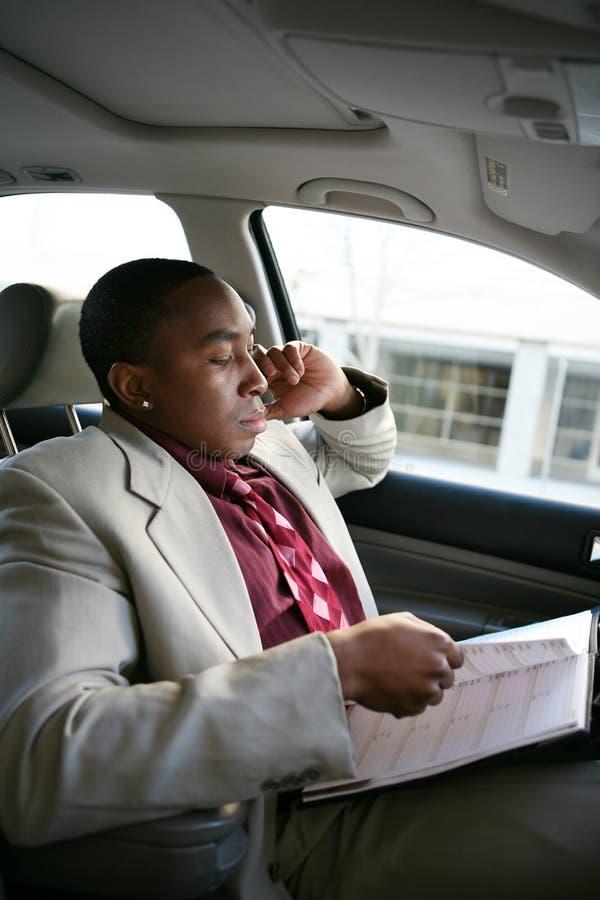 Homem de negócio no carro foto de stock