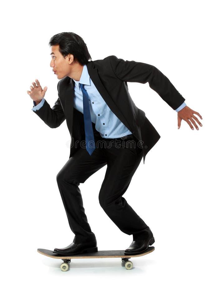 Homem de negócio no skate fotos de stock royalty free