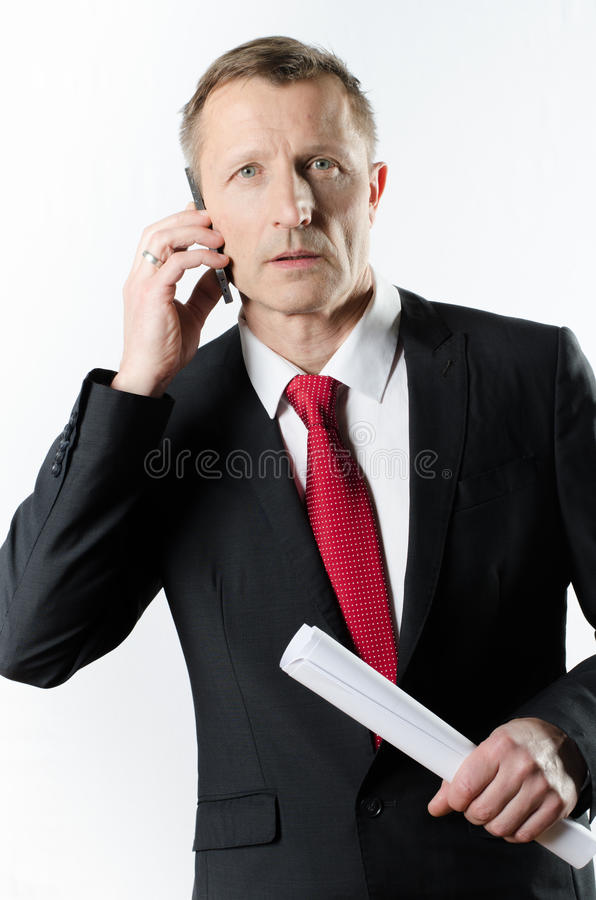 Homem de negócio no telefone foto de stock royalty free