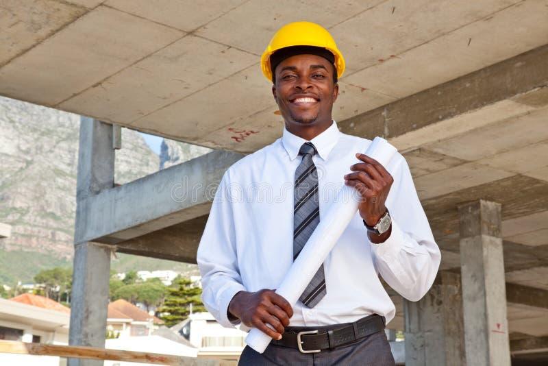 Homem de negócio no terreno de construção foto de stock royalty free