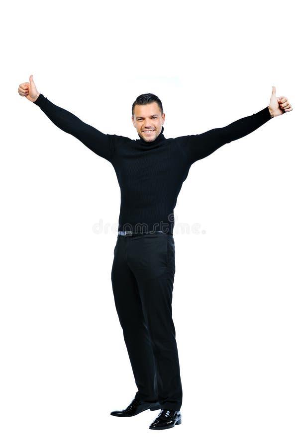 O homem de negócio novo de sorriso feliz com polegares levanta o gesto imagens de stock