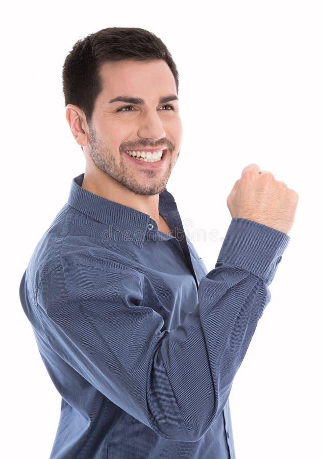 Homem de negócio novo orgulhoso e bem sucedido que faz o isolador do gesto do punho foto de stock