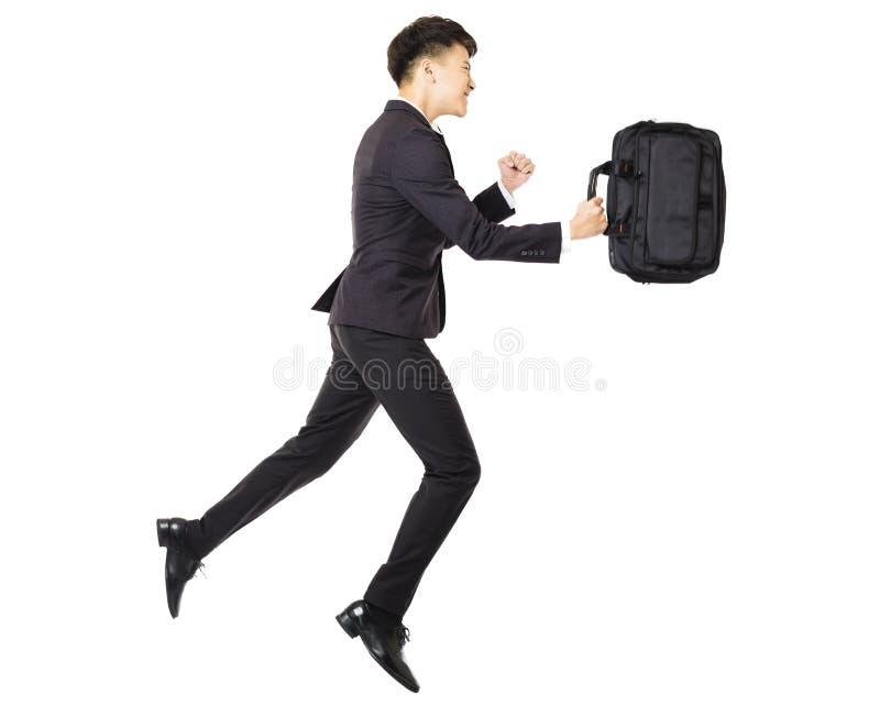 homem de negócio novo que corre com pasta fotografia de stock royalty free