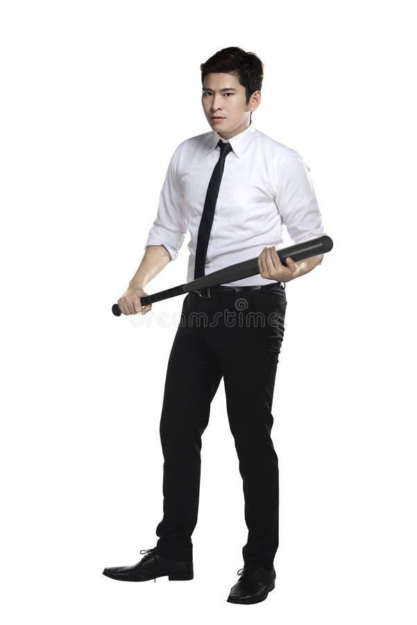 Homem de negócio novo que guarda o bastão de beisebol imagens de stock