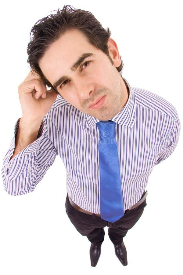 Homem de negócio novo que pensa no escritório imagens de stock royalty free