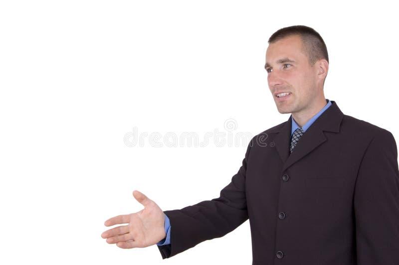 Homem de negócio pronto para agitar as mãos imagem de stock royalty free