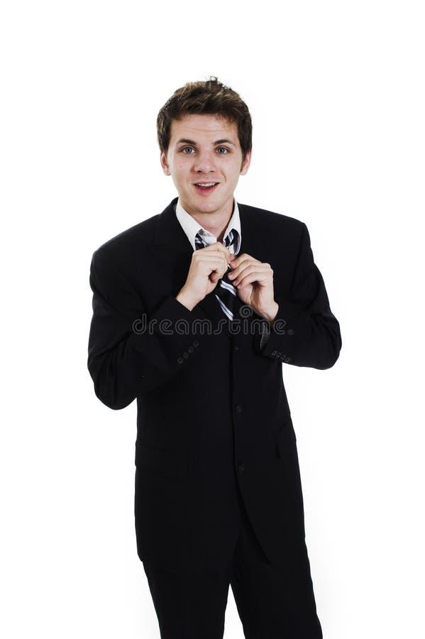 Homem de negócio que ajusta o laço imagens de stock royalty free
