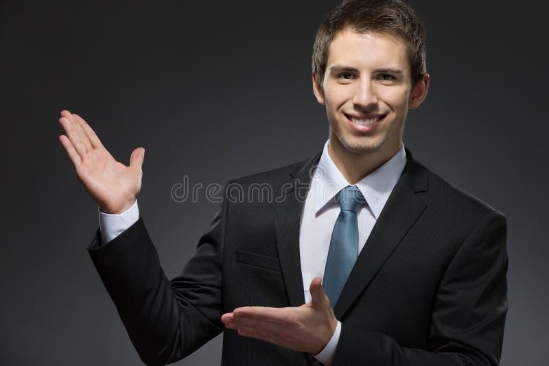 Homem de negócio que aponta com mãos imagens de stock