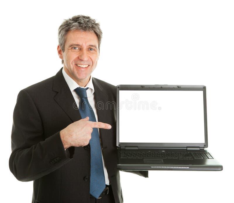 Homem de negócio que apresenta o laptopn fotos de stock