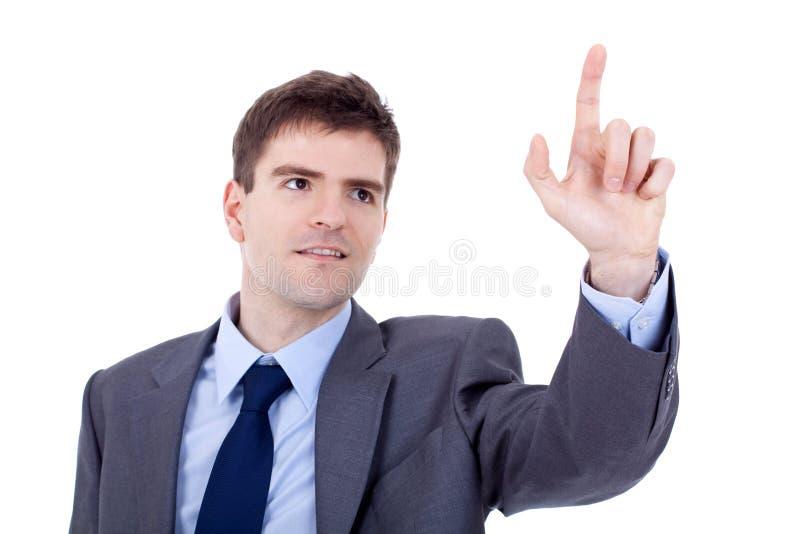 Homem de negócio que empurra uma tecla imaginária fotos de stock