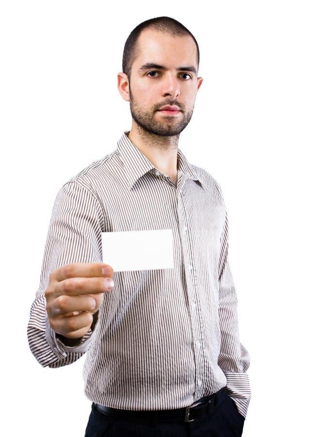 Homem de negócio que entrega um cartão em branco imagens de stock