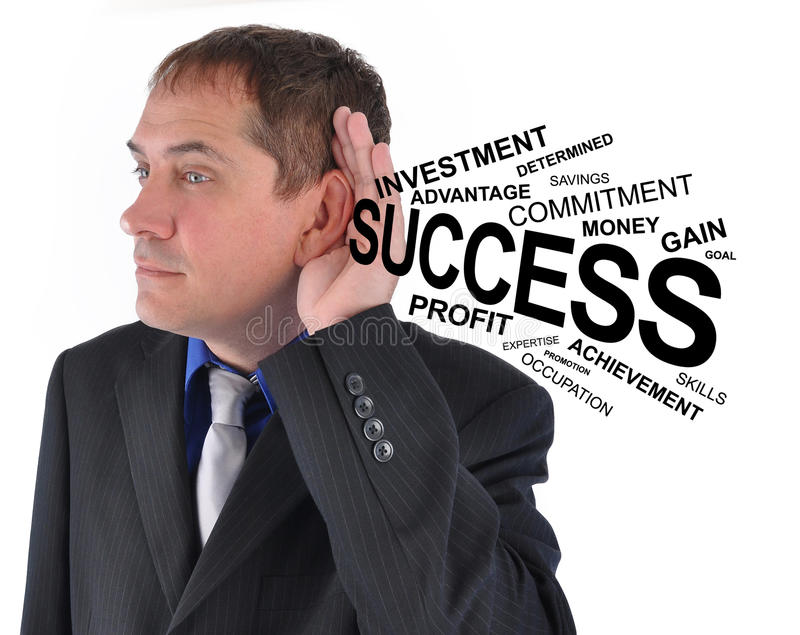 Homem de negócio que escuta a ajuda do sucesso foto de stock royalty free